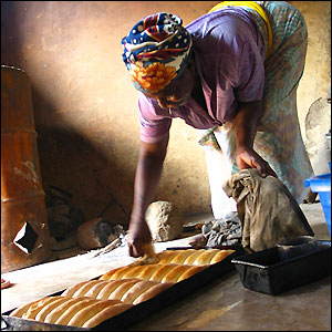 A Malawian woman working in a bakery, sent in by BBC News website reader Shiang Pei Kuo