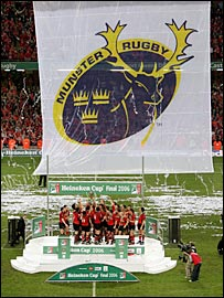 Munster celebrate beneath a massive banner after being crowned kings of Europe