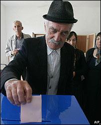 A Montenegrin voter casts his ballot