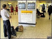 Passenger checking departure monitors at Heathrow