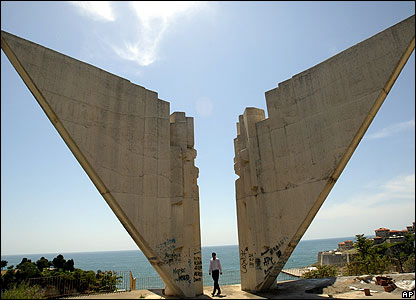 A man looks at the communist-era monument in the Adriatic town of Ulcinj, Montenegro
