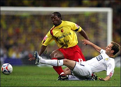 Leeds' Eddie Lewis tackles Watford's Lloyd Doyley