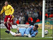 Leeds keeper Neil Sullivan is beaten by a deflection and the post