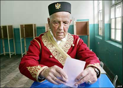 n elderly Montenegrin man, dressed in traditional uniform, casts his ballot in Podgorica