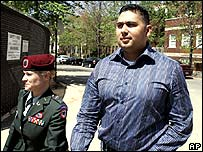 Sgt Santos Cardona (r) with one of his lawyers