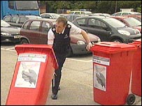 Red wheelie bins used for collecting knives