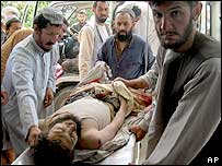 A  man injured in the air strike is carried to a Kandahar hospital