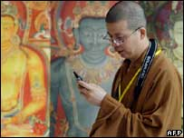Monk using mobile, AFP/Getty