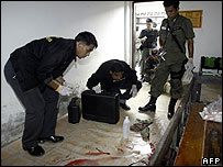 Forensics inspect the scene of the teacher hostage drama in Narathiwat province, Thailand