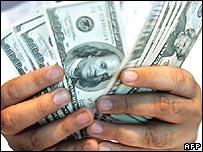 Man holding dollar bills