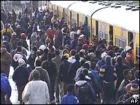 African commuters rushing for a train