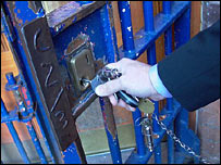 Officer unlocking prison gate
