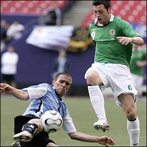 Carlos Valdez challenges Northern Ireland's Ivan Sproule