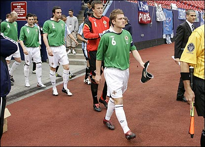 Steve Davis leads out Northern Ireland for the friendly against Uruguay