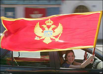 A girl waves a Montenegrin flag from a car in Montenegro's capital, Podgorica