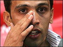 Middle-distance legend Hicham El Gurreouj wipes away a tear as he announces his retirement from athletics