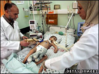 Doctors treat a young patient at a Gaza City hospital