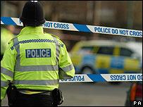 Police officer in front of crime scene