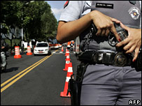 A policewoman holds her gun at a checkpoint in Sao Paulo