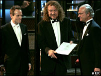 John Paul Jones (left) and Robert Plant (centre) from Led Zeppelin, with Swedish King Carl XVI Gustaf