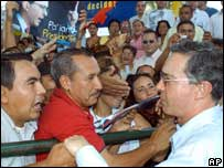 President Alvaro Uribe (right) greets supporters on the campaign trail on 22 May