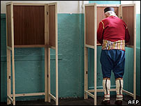 A Montenegrin man dressed in traditional uniform to cast his ballot in Podgorica