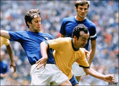 Brazil's Tostao holds off the challenge of Italy's Rosato during the 1970 World Cup final in Mexico