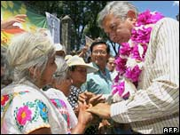 Andres Manuel Lopez Obrador (right) greets supporters on the campaign trail