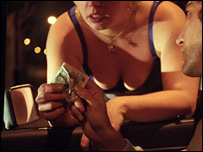 A prostitute takes money