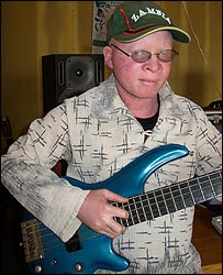 Geoffrey Zigoma playing a guitar