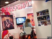 A man in the Bollywood stand in the Cannes Market section