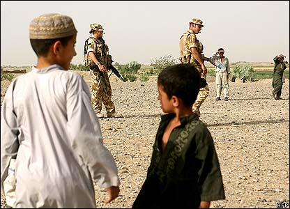 Afghan children in Helmand watch British soldiers