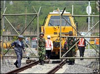 South Koreans work on the new train line