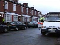 Police van outside Moss Side address raided