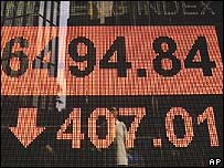 Electronic price board showing drop in Asian stocks