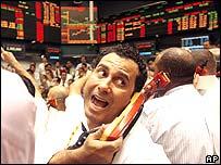 Stock market trader talking on phone