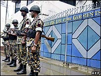 Members of the paramillitary Bangladesh Rifles (BDR) stand guard in front of a garments factory at the Tejgon industrial area in Dhaka