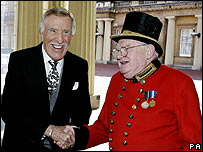 Bruce Forsyth is greeted at Buckingham Palace by state Porter Douglas Drawbridge