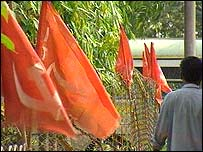 A man walks past a row of communist flags in Calcutta