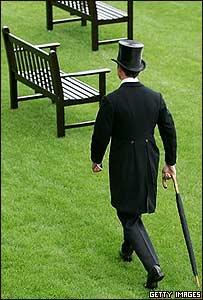 Hombre de traje y sombrero de copa.