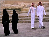 Men and women walk in the capital Riyadh