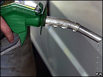 Petrol dripping out of a pump nozzle