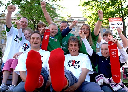 John Inverdale kicks off his tour in Belfast with local racing driver Colin Turkington and red socks galore
