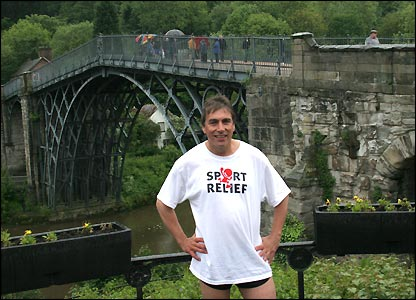 John Inverdale poses in front of the magnificent Iron Bridge in Shropshire