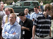 People gather outside court for the verdict in the Enron case