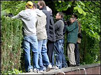 Journalists and photographers try to get a glimpse as Rooney arrives at the hospital in Manchester