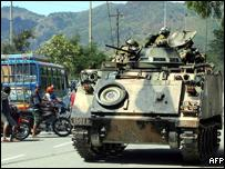 Australian soldiers aboard an armoured vehicle patrol in Dili