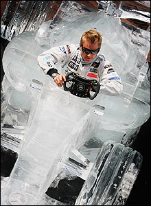 Kimi Raikkonen poses in an ice model of a McLaren organised by the team's sponsor Steinmetz Diamonds