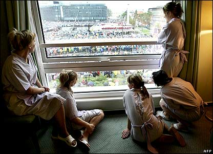 Hotel workers watch mass
