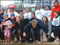 John Inverdale is joined by an enthusiastic crowd on the beach in Newquay